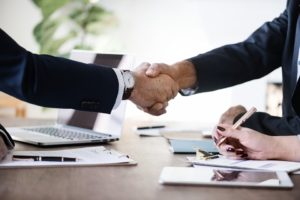 Two business people shaking hands.