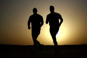 Silhouettes of two runners