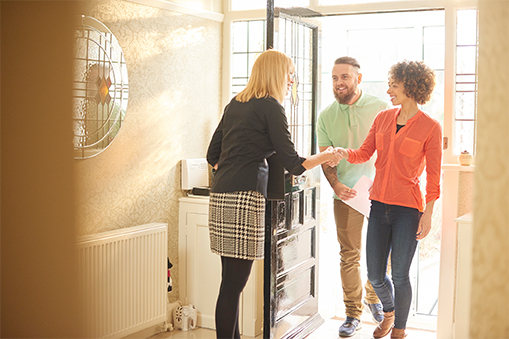 buyers checking out a home with an agent